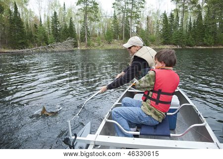 Young Boy Fisherman Catches A Walleye