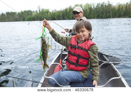 Young Fisherman Proudly Shows First Walleye Of The Day