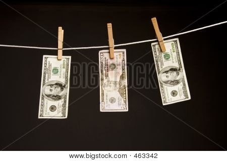 3 Dollar Bills Hanging On Clothes Line