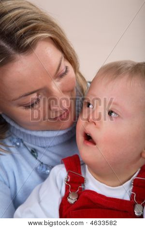 Portrait Of A Mother Young Son With Down Syndrome.