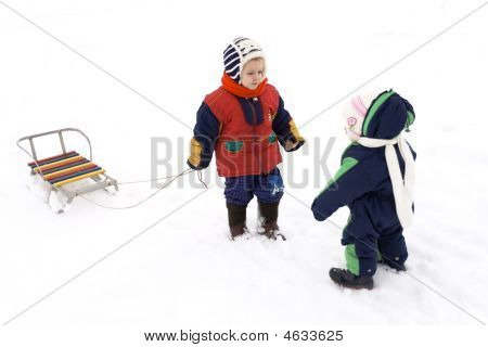 Children With Sled On Snow