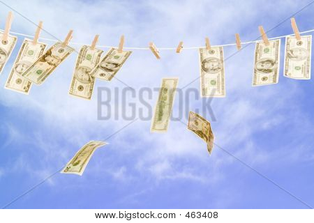 U.s. Currency Hanging On Clothesline