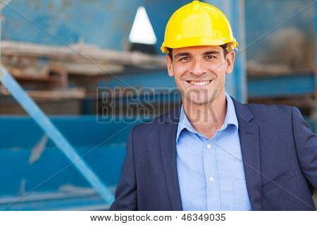handsome modern industrial manager portrait in front of machinery