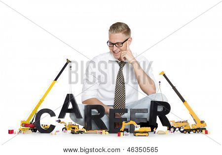 Build up career concept: Smiling businessman building the word career along with construction machines, isolated on white background.