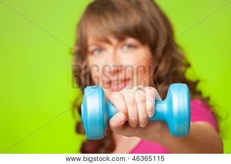 Woman doing exercise with dumb bell, strengthen her arms and shoulders