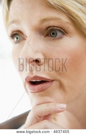 Head Shot Of Woman Thinking