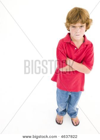 Young Boy With Arms Crossed Scowling