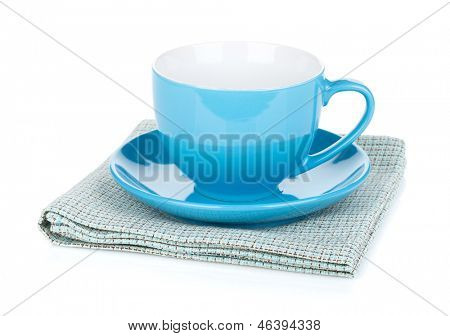 Blue coffee cup over kitchen towel. Isolated on white background