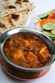 stock photo of kadai  - Kadai paneer cheese curry in a cardamon gravy with naan bread and salad - JPG