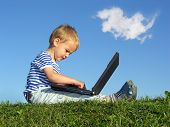 stock photo of bobbies  - child with notebook sit blue sky with cloud - JPG
