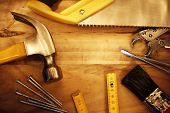 stock photo of hardware  - A variety of tools on wood - JPG