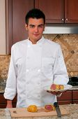 image of beef wellington  - Male chef with beef wellington - JPG