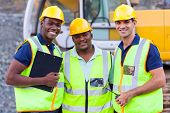 stock photo of heavy equipment operator  - portrait of smiling construction workers - JPG