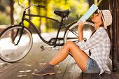 image of spring break  - pretty female university student take a break outdoors - JPG