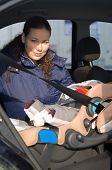 Mother And Baby In Safety Seat