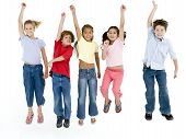 stock photo of children group  - Studio shot of five young children on white background jumping and smiling - JPG