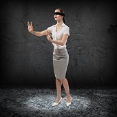 stock photo of blindfolded man  - young blindfolded woman - JPG
