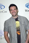 ANAHEIM, CA - MARCH 31: Colin Donnell arrives at the 2013 Wondercon convention press room at the Ana