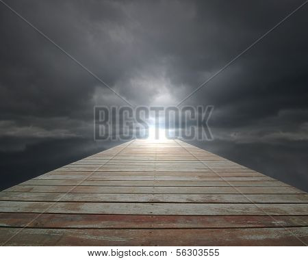 Wooden Way With Cloudy Sky And Spot In Front