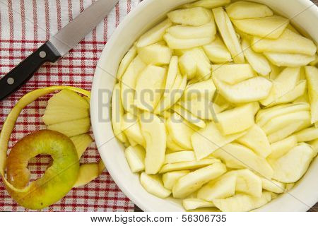 Sliced Apples With Peel And Knife For An Apple Pie