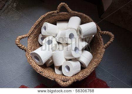 Toilet paper rolls in a basket.