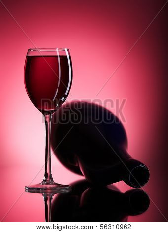 filled wine glass and pitcher