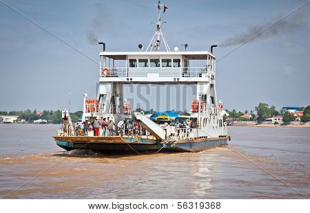 NEAK LEUNG, CAMBODIA - NOV 19, 2013: Ferry across the Mekong on Nov 19, 2013, in Neak Leung, Cambodia. Kingdom of Cambodia is a country located in Southeast Asia. Population of over 14.8 million.