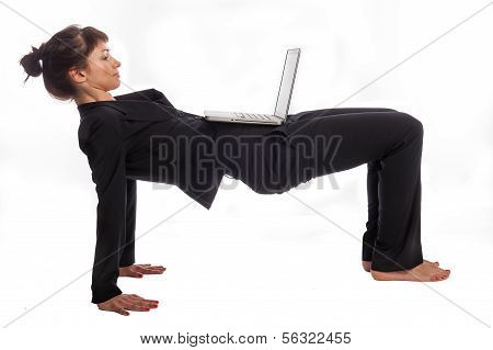 Woman Doing Yoga At Work.