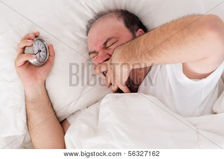 Man Yawning As He Tries To Wake Up