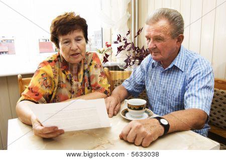 Senior Couple Studying Document