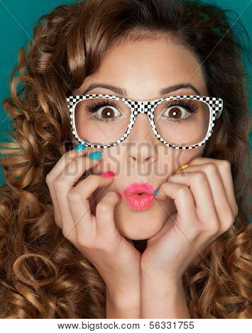 Young attractive surprised woman wearing glasses
