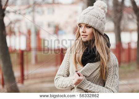 Fashionable Stylish Girl In White Knit Jacket