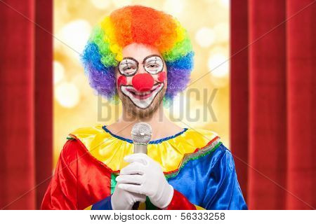 Funny clown speaking into the microphone