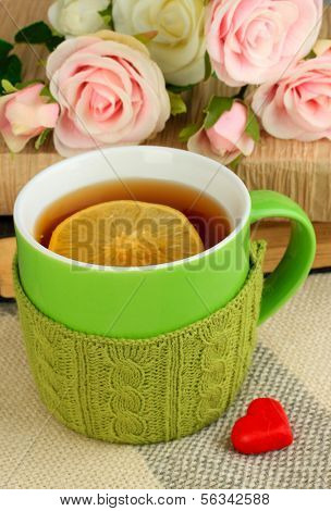 Cup of tea with knitted thing on it close up