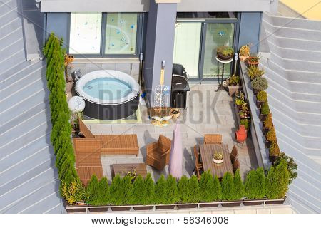 Terrace On The Roof With Green Garden And Jacuzzi Tub