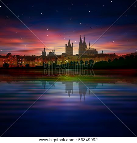 Abstract Background With Silhouette Of Cologne And Sunrise