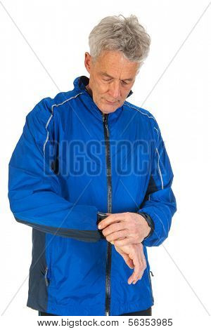 Senior runner is taking the time with watch isolated over white background