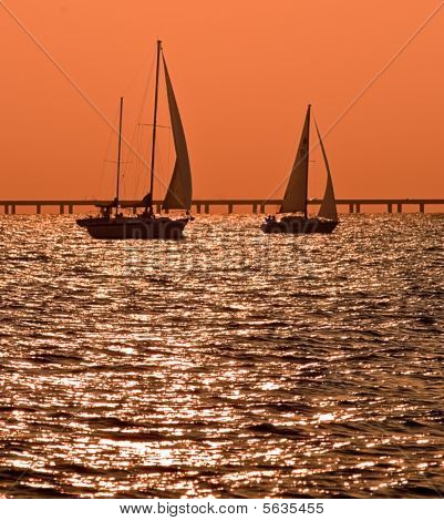 Two Sailboats At Dusk