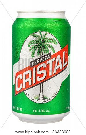 HAVANA,CUBA - DECEMBER 25, 2013:Authentic cuban beer Cristal isolated on white.With an alcohol content of just 4.9% this light beer is the favorite of locals and foreign tourists visiting Cuba