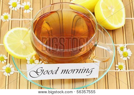 Good morning card with cup of tea, chamomile flowers and lemon