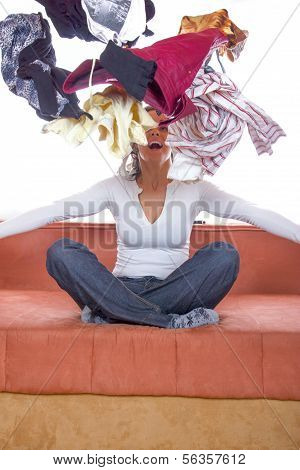 Girl Sitting And Throwing Clothes In The Air