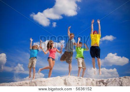 Family happy jump