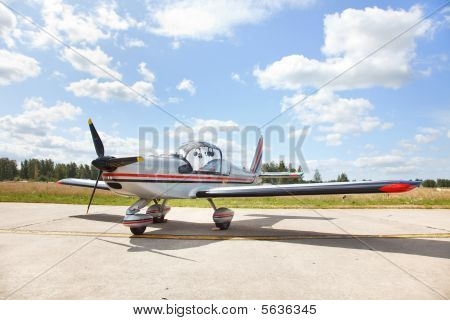 Small Airplane On Landing Strip
