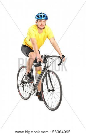 Young male biker looking at camera, isolated on white background