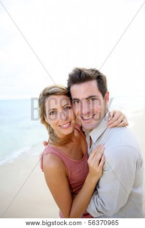 In love couple embracing by the beach
