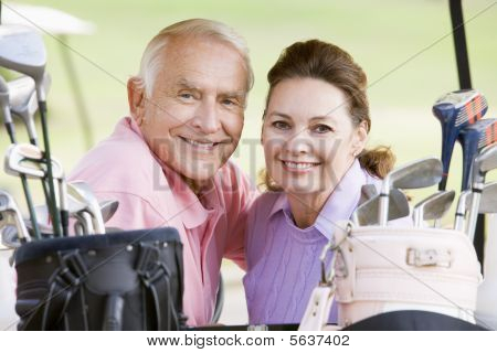 Couple Enjoying A Game Of Golf