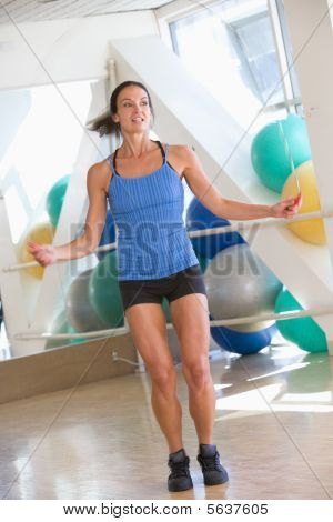 Woman Using Skipping Rope At Gym