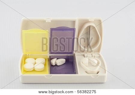 Pill Box And Split Blade Tablet Show Medicine Concept