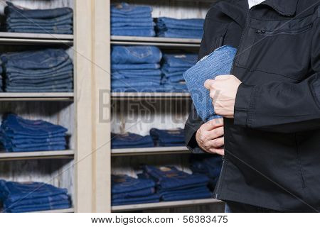 Shoplifter Stealing Denim