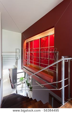 Stairs And A Red Wall